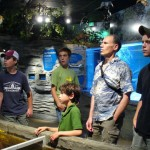 Photo of people inside the man made cave of wolf Creek National Fish Hatchery