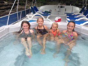 Photo of kids in a Lake Cumberland State Dock Houseboat Hot tub