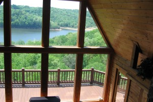 photo of a log cabin with large glass windows . Log cabin with a view of Lake Cumberland