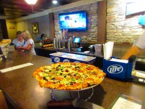 photo of Cumberland Tap bar with pizza on the counter.  Lake Cumberland waterfront dining.