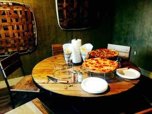 photo of Lake Cumberland restaurant The Cumberland Tap with pizza and plates on the table.
