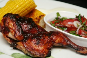 A photo of BBQ chicken, corn on the cob and a salad - Lake Cumberland dining.