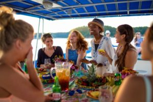 Photo of a group of girls eating and laughing on a Lake Cumberland houseboat