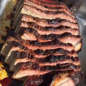 Photo of BBQ meat cooking at Lake Cumberland L.C. Tiki Bar and Restaurant at State Dock Marina