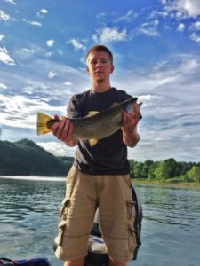 Photo of a man holding a trout on the Cumberland River