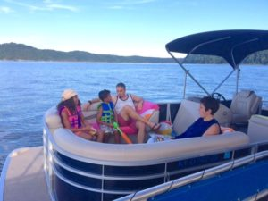 photo of a family enjoying the day on Lake Cumberland in a pontoon